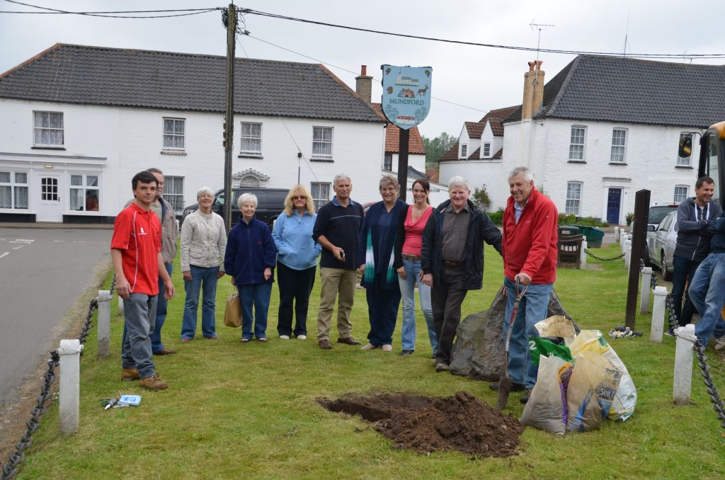 Councillors & villagers watch as the soil is about to be replaced